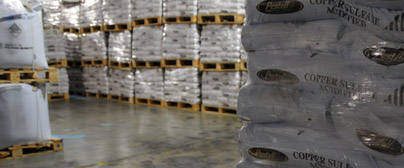 Pestell photo of bagged product in warehouse